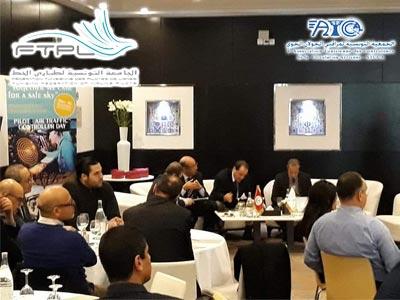 Ensemble, nous oeuvrons pour un ciel sécurisé slogan du 2ème symposium de la FTPL